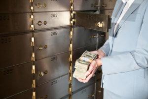 Putting cash in safety deposit box
